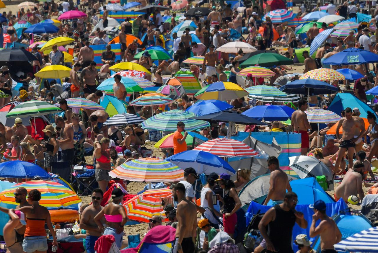 FILE PHOTO: People enjoy the hot weather at the beach in Bournemouth