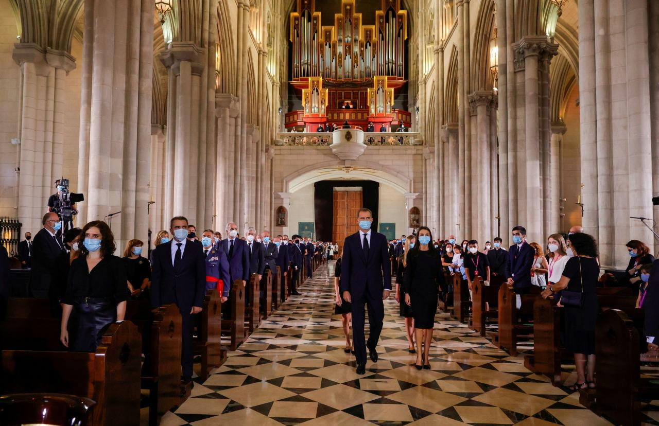 King Felipe and Queen Letizia of Spain arrive to attend a funeral mass for the coronavirus disease (COVID-19) victims at La Almudena Cathedral in Madrid