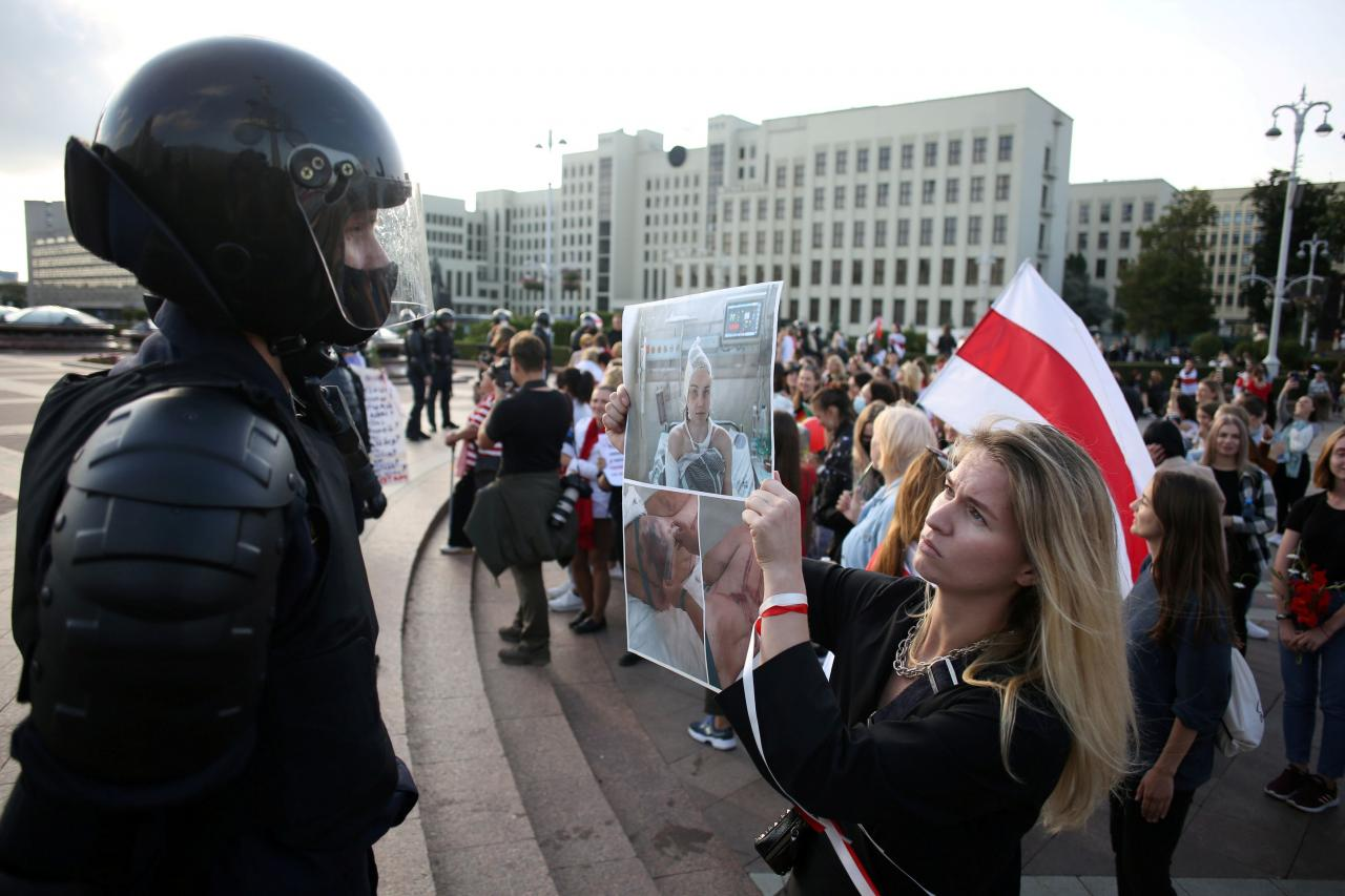 Women take part in a rally against police brutality following protests to reject the presidential election results in Minsk