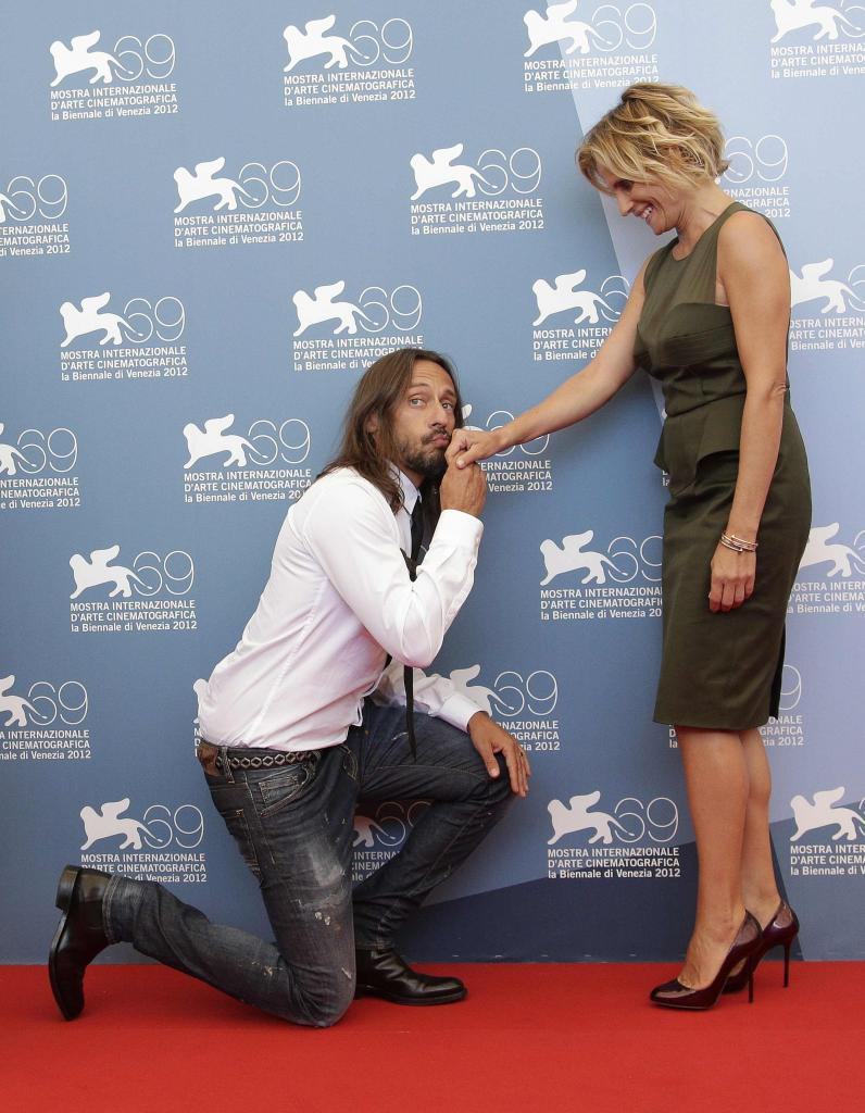 "Members of the jury ""Opera Prima"" French D.J. Sinclar and Italian actress Ferrari pose during a photocall at the 69th Venice Fil"