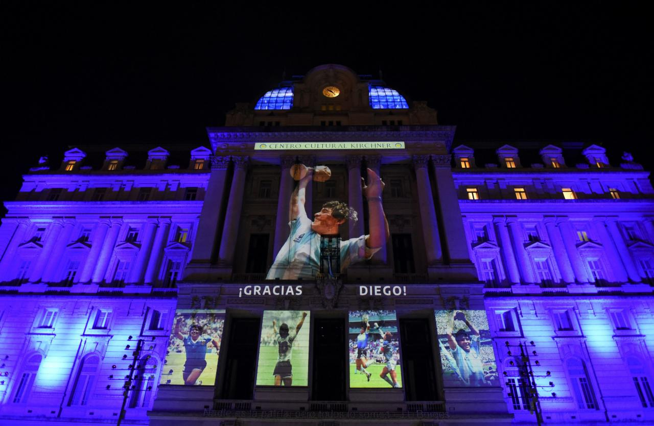Photographs of late soccer legend Diego Maradona are projected on the Kirchner Cultural Centre, in Buenos Aires