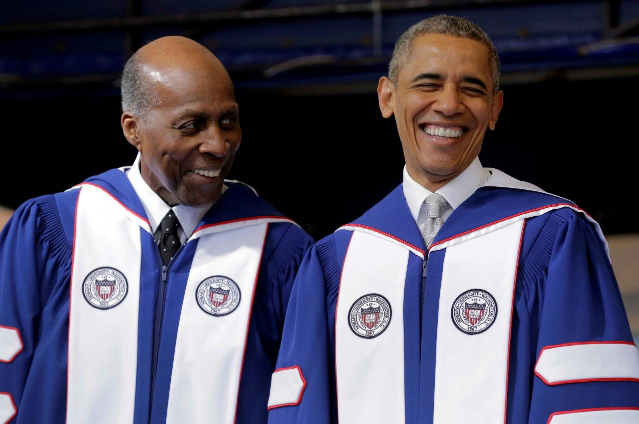 FILE PHOTO: FILE PHOTO: U.S. President Barack Obama smiles as he speaks with Vernon Jordan before delivering the commencement address to the 2016 graduating class of Howard University in Washington