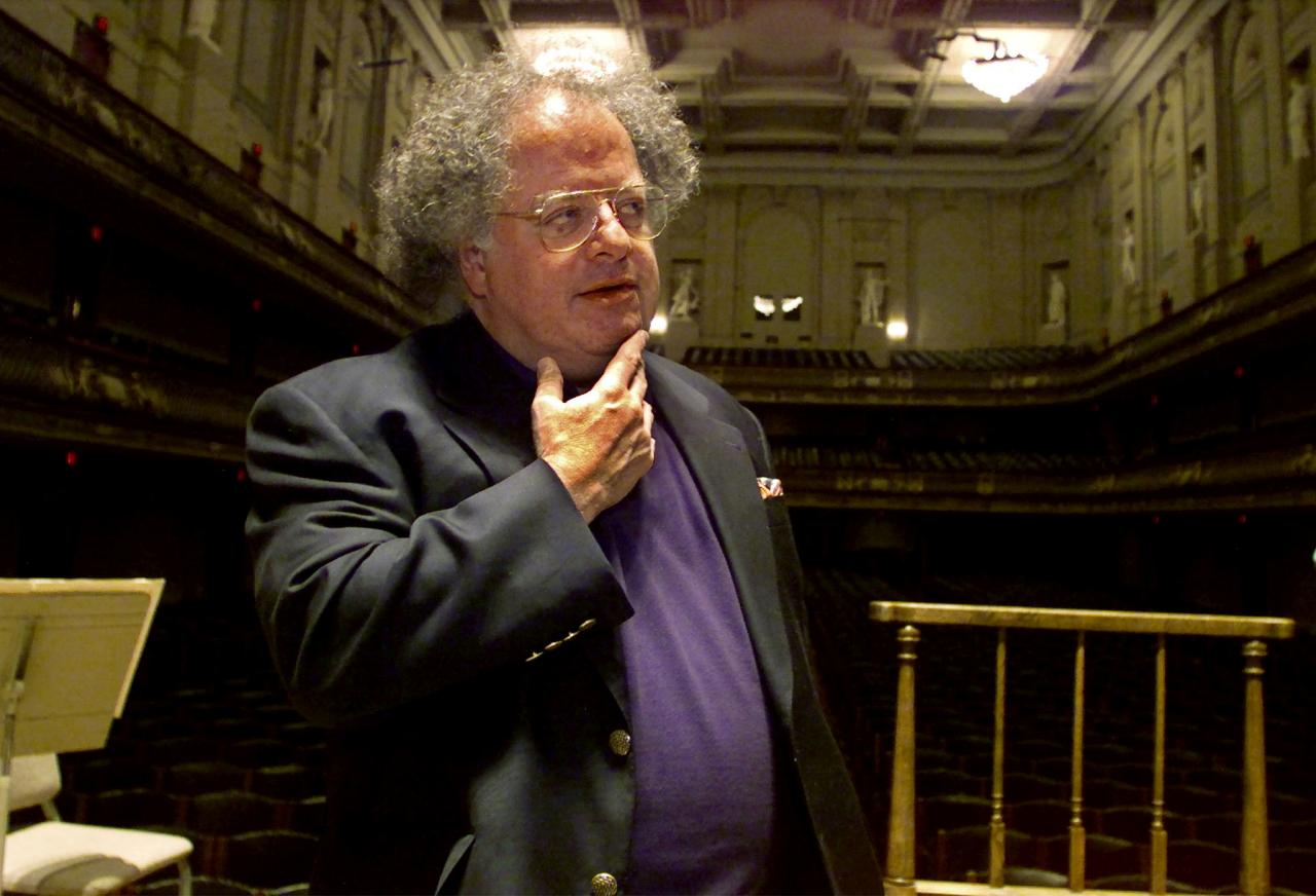 FILE PHOTO: James Levine pauses as he looks over the stage and conductor's podium in Boston's Symphony Hall