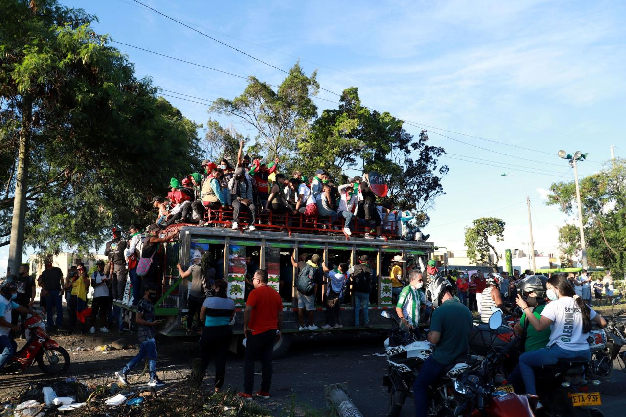 Colombian indigenous people travel on buses to participate in a protest against poverty and police violence in Cali