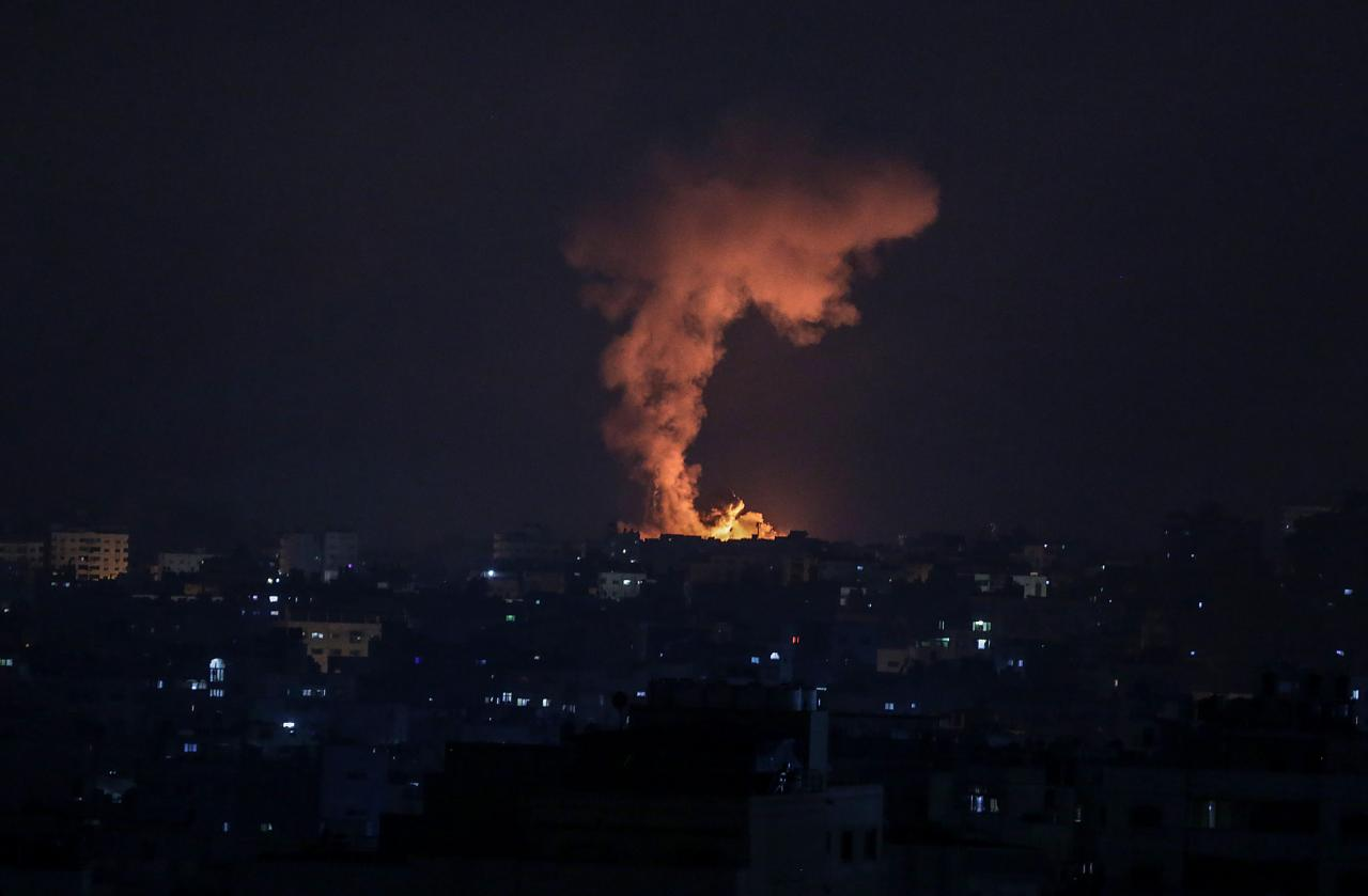 Smoke and flames rise after an Israeli airstrike in the northern Gaza strip