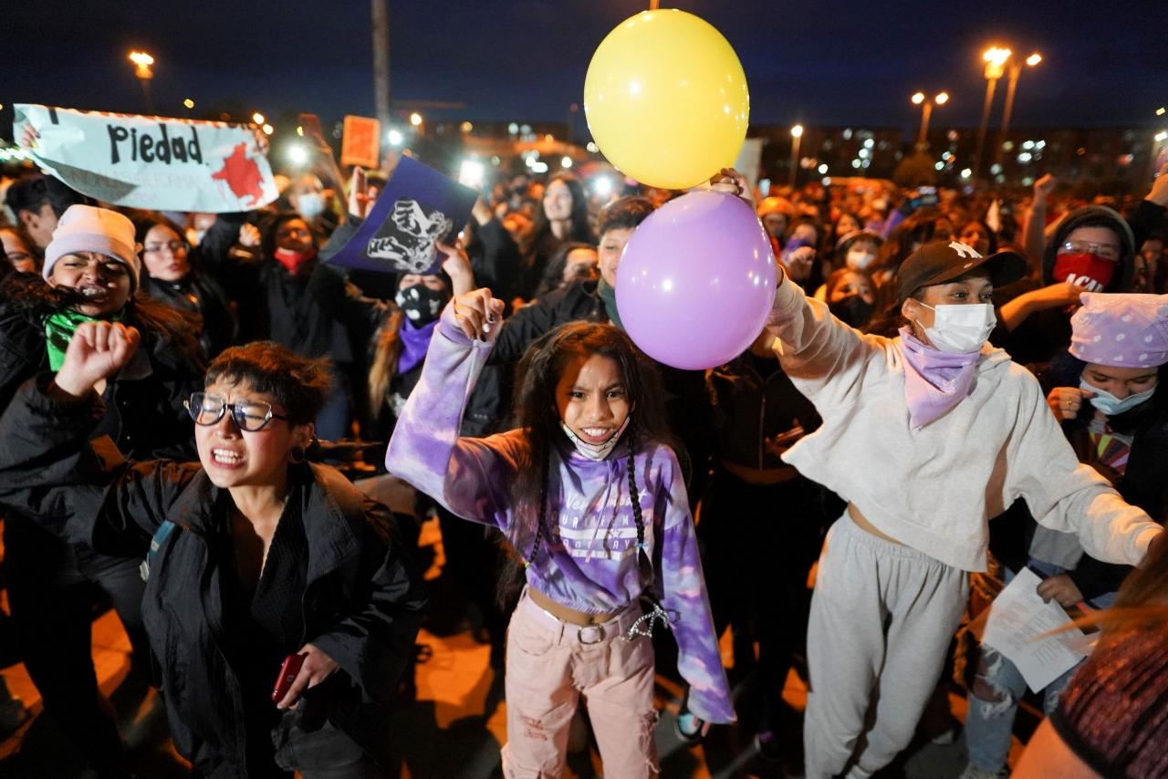 Women take part in a protest against sexual assault by the police and the excess of public force against peaceful protests, in Bogota