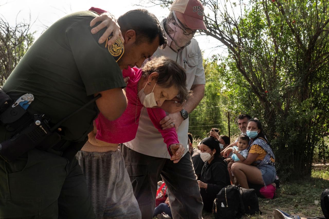 Asylum-seeking migrants cross the Rio Grande river in Del Rio
