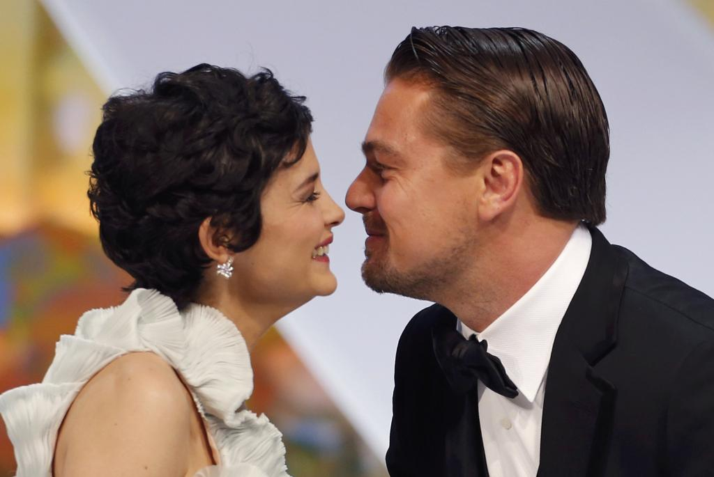 Actor Leonardo DiCaprio kisses Mistress of Ceremony actress Tautou during the opening ceremony of the 66th Cannes Film Festival