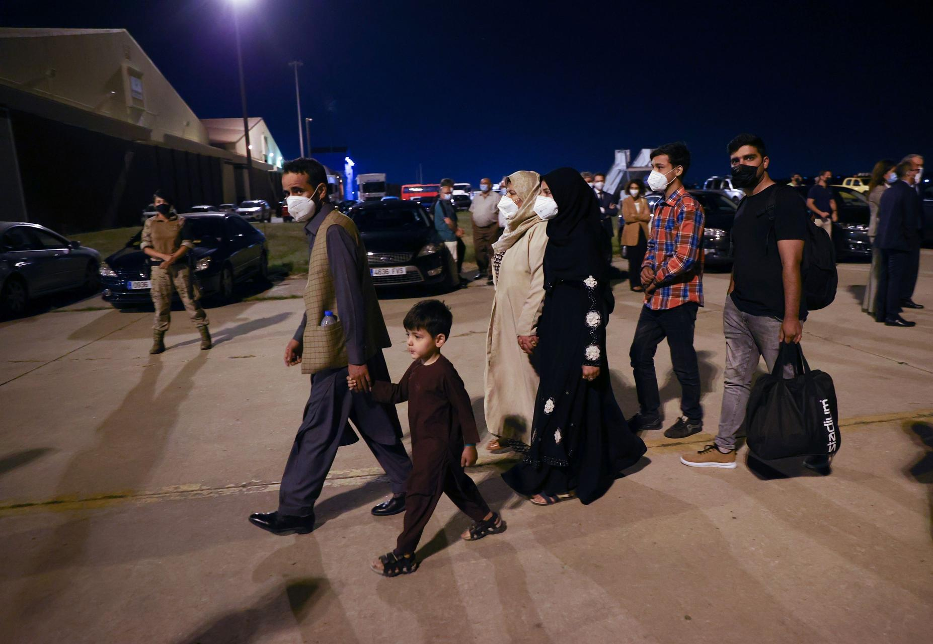 Spanish and Afghan citizens who were evacuated from Kabul arrive at Torrejon airbase in Torrejon de Ardoz
