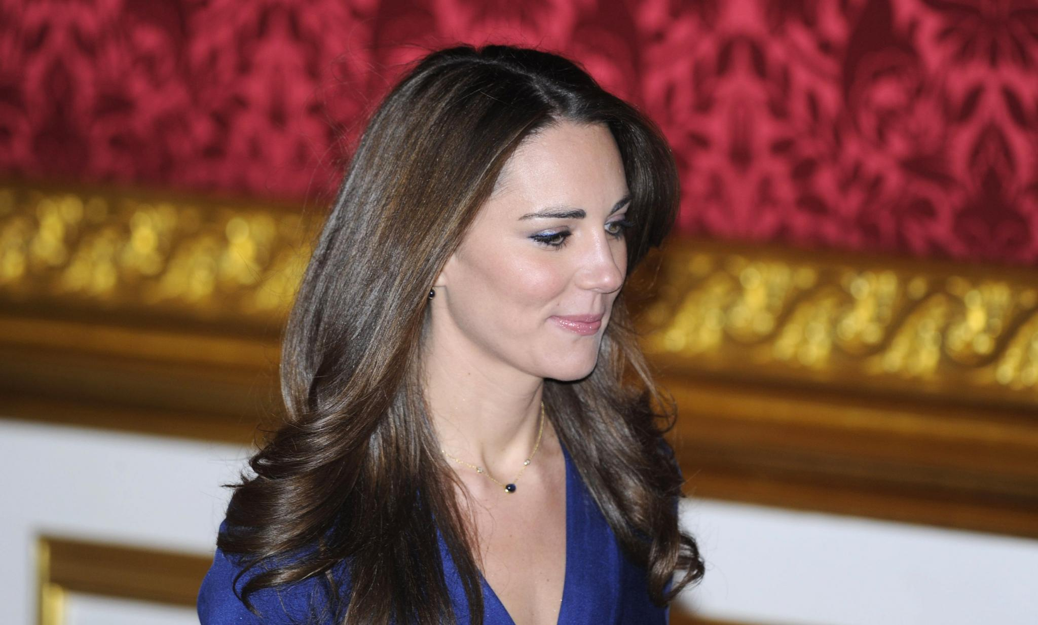 The fiancee of Britain's Prince William, Kate Middleton, prepares to pose for a photograph in St. James's Palace in central Lond