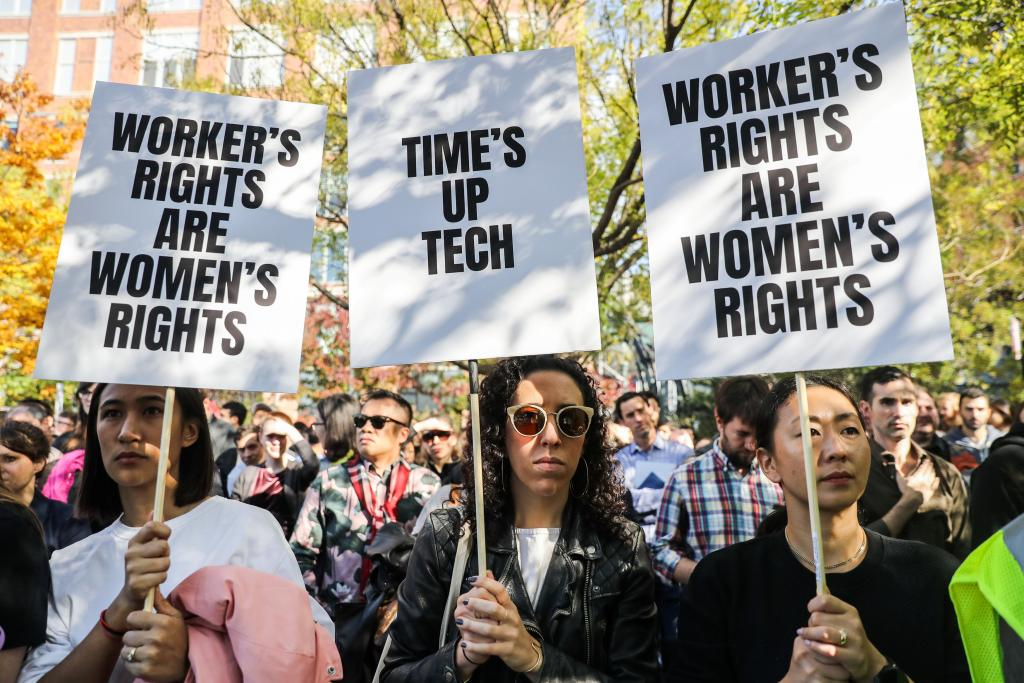 Workers hold signs outside 14th Street Park across the Google offices after walking out as part of a global protest over workpla