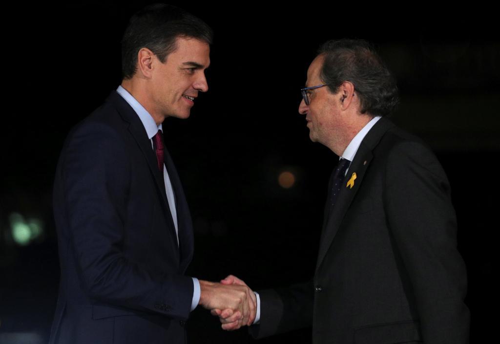 Pedro Sánchez saluda a Quim Torra