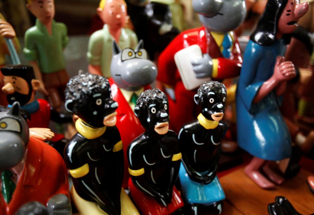 FILE PHOTO: Shelves crammed with figurines from Belgian comic strips Tintin and Le Chat are displayed at the workshop of Congole
