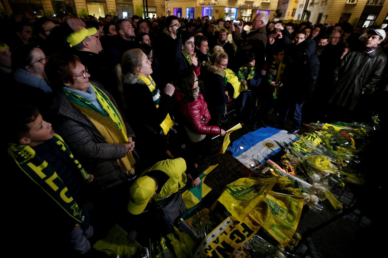 Fans gather near a row of yellow tulips in Nantes' city center after news that newly-signed Cardiff City soccer player Emiliano
