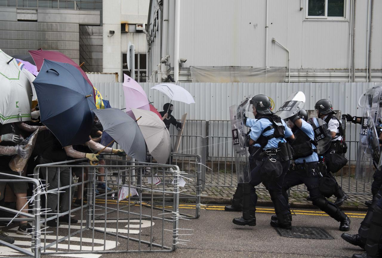 01 July 2019, China, Hong Kong: Policemen clash with protesters during demonstration against the Chinese government on the occas