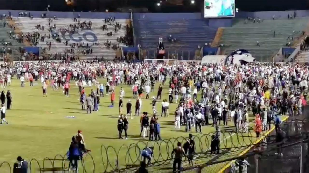 Soccer fans walk in a football field in Tegucigalpa