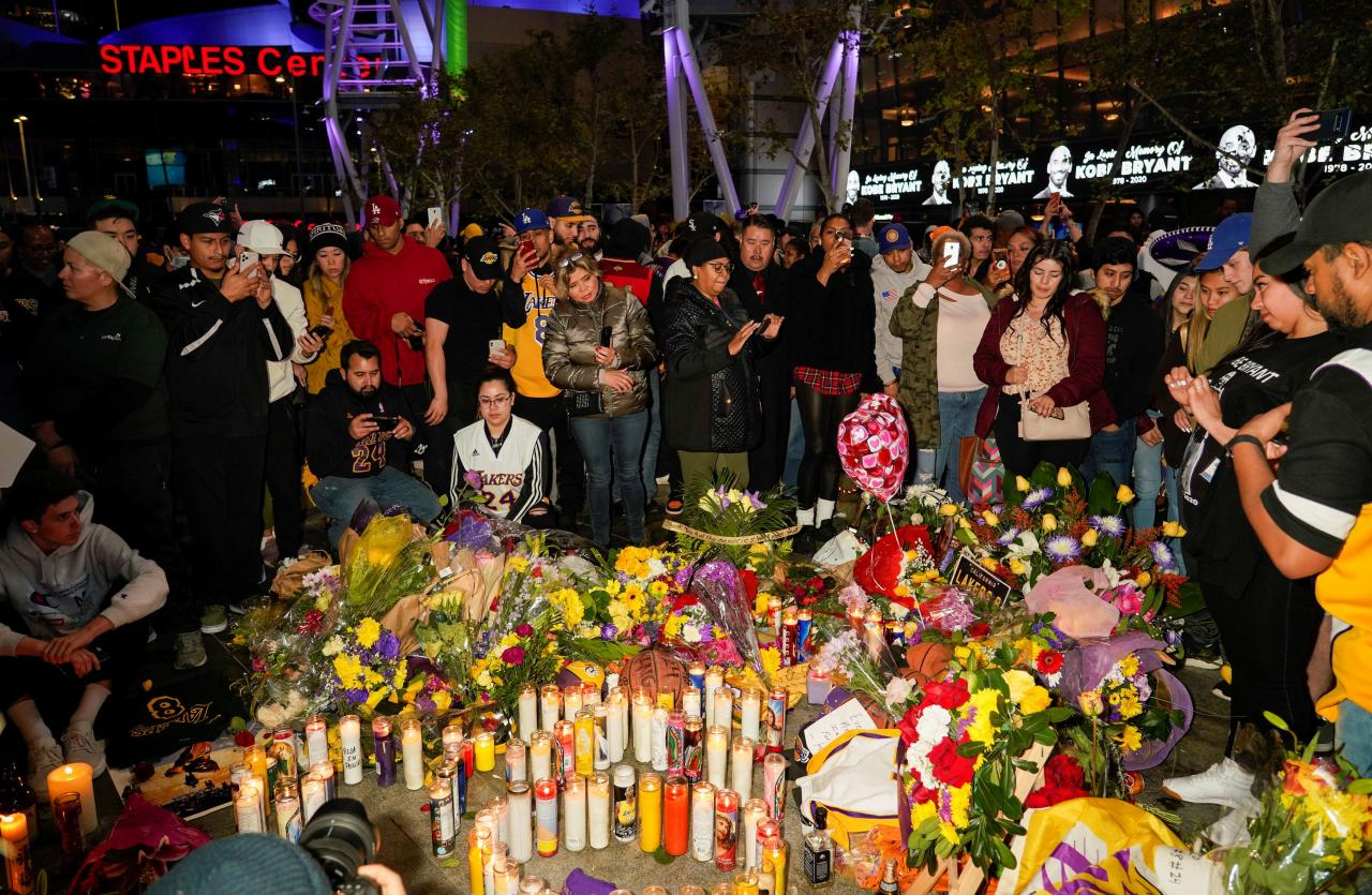 Mourners gather in Microsoft Square near the Staples Center to pay respects to Kobe Bryant after a helicopter crash killed the retired basketball star, in Los Angeles
