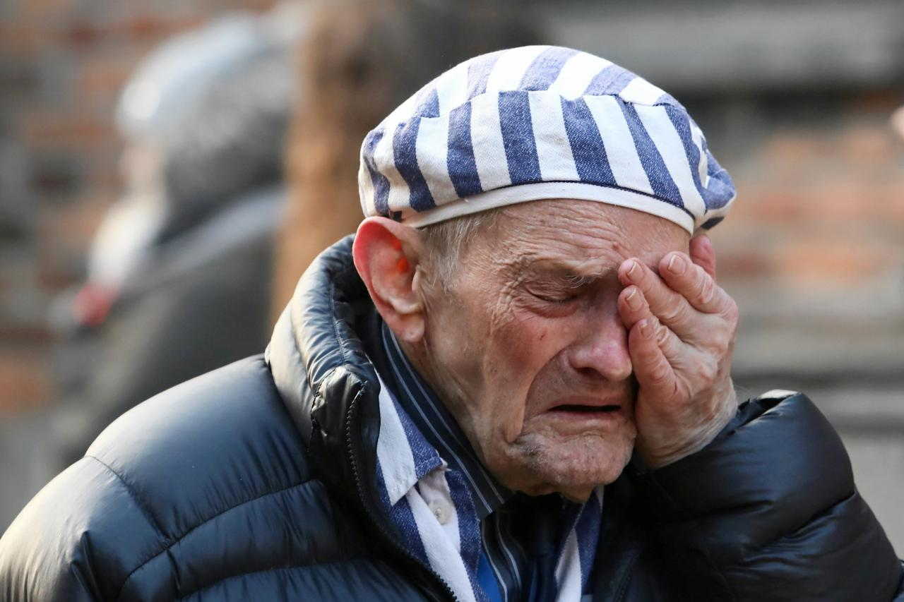A survivor reacts at the former Nazi German concentration and extermination camp Auschwitz during a wreath-laying ceremony in Oswiecim