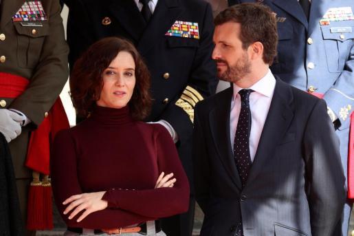 La presidenta de la Comunidad de Madrid, junto al líder nacional de su partido en un reciente acto oficial.