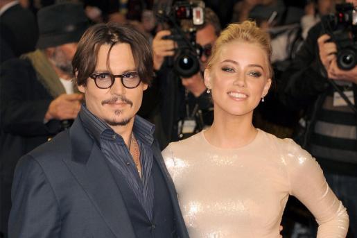 Los actores Johnny Deep y Amber Heard.