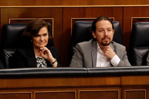 La vicepresidenta primera, Carmen Calvo, y el vicepresidente segundo, Pablo Iglesias, han trabajado en el acuerdo