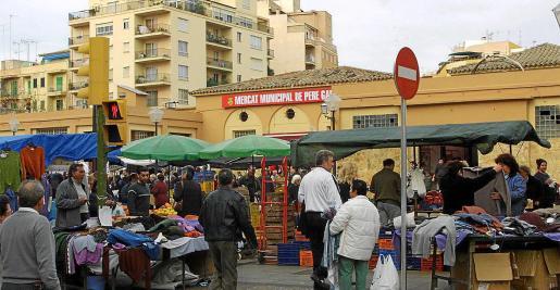 La plaza de Pere Garau es el centro neurálgico del barrio, el más poblado de toda la ciudad de Palma.