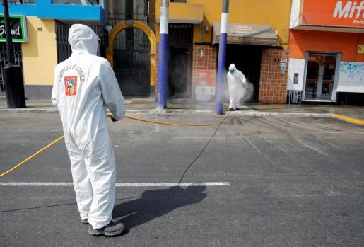 Municipal workers clean the streets and the facades in the Chorrillos neighborhood as Peru's government considers extending the days of the state of emergency and curfew to stop the spread of the coronavirus disease (COVID-19), in Lima, Peru March 21, 2020. Picture taken March 21, 2020. REUTERS/Sebastian Castaneda NO RESALES. NO ARCHIVES HEALTH-CORONAVIRUS/PERU