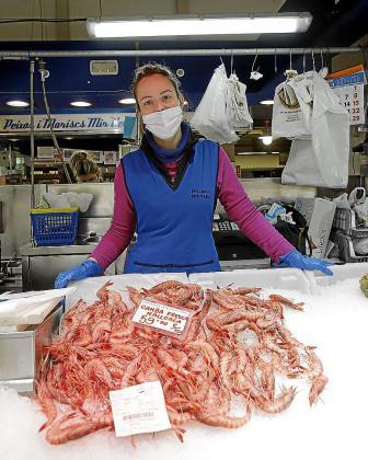 Marina Ferragut, en su puesto del Mercado del Olivar.