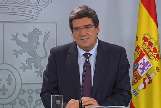 Captura de vídeo de la señal institucional del Palacio de la Moncloa, del ministro de Migraciones y Seguridad Social, José Luis Escrivá, durante la rueda de prensa que ha ofrecido este miércoles.