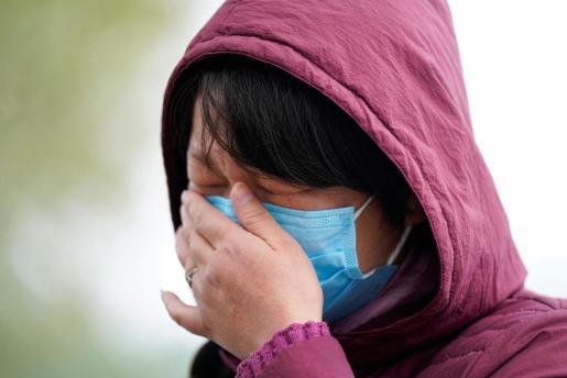 Una ciudadana china, con mascarilla.