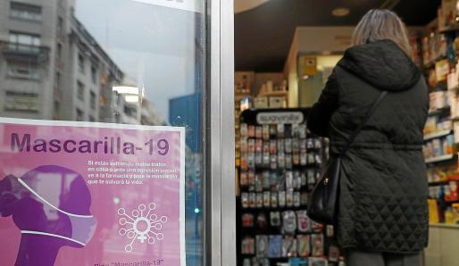Anuncio contra la violencia de género en una farmacia.