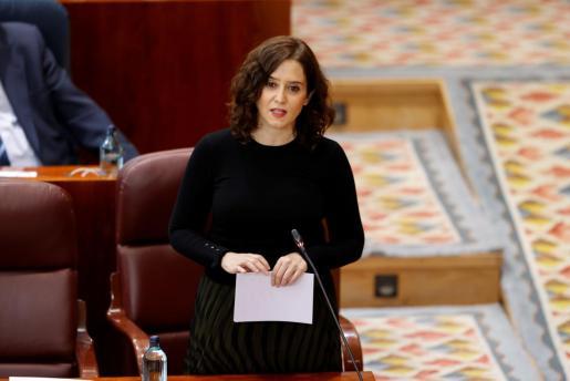 La presidenta de la Comunidad de Madrid, en una imagen de este pasado jueves en el pleno de la Asamblea regional, donde la desescalada fue parte del orden del día.