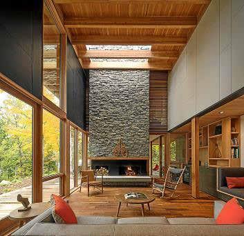 Un ambiente típicamente 'mid century', con profusión de materiales naturales, grandes ventanales, techos altos y líneas rectas.