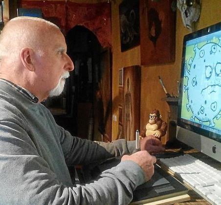 Andrew Pinder trabajando en su casa de Selva.