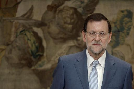 Spain's Prime Minister Mariano Rajoy attends the naming of the High Commissioner for the Spain brand at Moncloa palace in Madrid July 12, 2012. Rajoy announced a swathe of new taxes and spending cuts designed to slash 65 billion euros from the budget deficit by 2014 as recession-plagued Spain struggles to meet tough targets agreed with Europe. REUTERS/Andrea Comas (SPAIN - Tags: POLITICS BUSINESS)