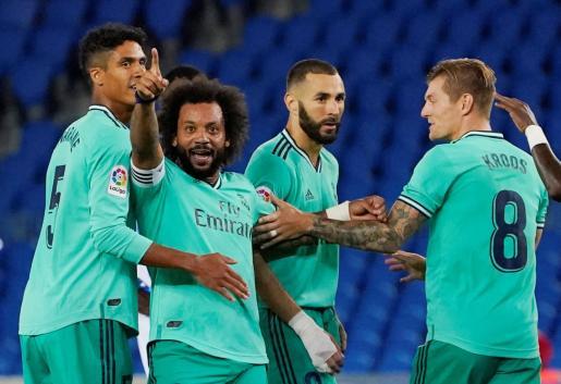 Karim Benzema, junto a Marcelo y otros jugadores del Madrid, ha regresado en un gran momento de forma. Quiere el Pichichi.