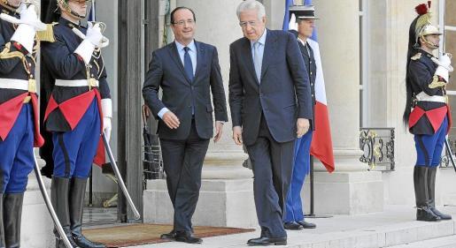 François Hollande y Mario Monti coinciden en señalar que se dan pasos «significativos» para estabilizar la economía europea.