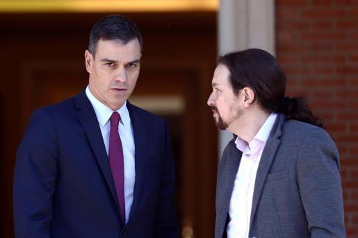 El presidente del Gobierno, Pedro Sánchez (i),junto al líder de Unidas Podemos, Pablo Iglesias (d), en una imagen de archivo.