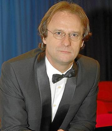 Joan Company, director de coros y orquesta.
