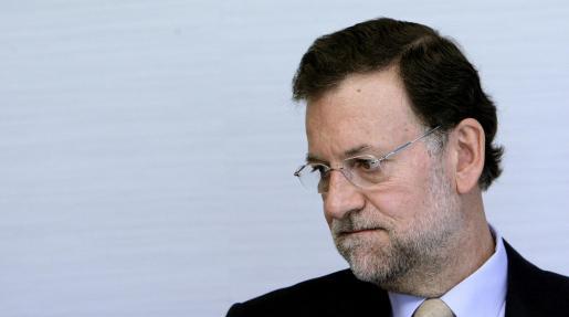 El presidente del PP, Mariano Rajoy, durante la reunión que mantuvo ayer en Madrid con representantes de la Fundación Innovación España.