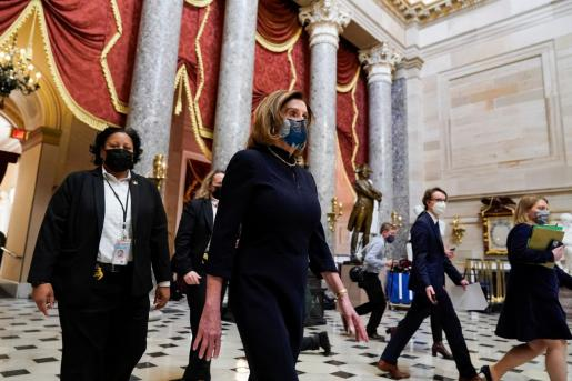 U.S. House Speaker Nancy Pelosi (D-CA) walks to her office, as Democrats debate one article of impeachment against U.S. President Donald Trump at the U.S. Capitol, in Washington, U.S. January 13, 2021. REUTERS/Joshua Roberts USA-TRUMP/