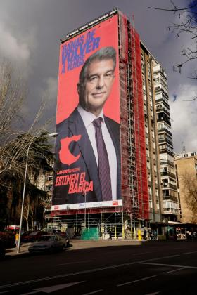 FILE PHOTO: A giant electoral poster of FC Barcelona presidential hopeful Joan Laporta is seen on a building next to the Santiago Bernabeu Stadium in Madrid, Spain - December 15, 2020. REUTERS/Juan Medina/File Photo SOCCER-SPAIN-FCB/ELECTION