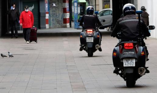 Una patrulla de la Policía Nacional motorizada.
