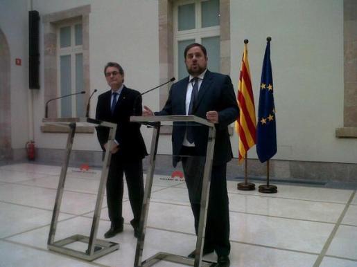 El líder de CiU, Artur Mas, y el presidente de ERC, Oriol Junqueras,esta mañana.