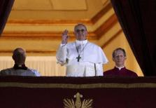 Newly elected Pope Francis, Cardinal Jorge Mario Bergoglio of Argentina appears on the balcony of St. Peter's Basilica at the Va