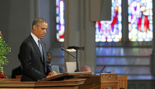 U.S. President Barack Obama speaks during an interfaith memorial service at the Cathedral of the Holy Cross for the victims of the Boston Marathon bombing in Boston, Massachusetts April 18, 2013.