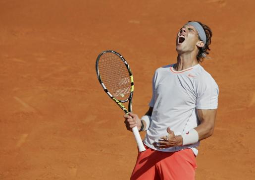 Rafael Nadal of Spain reacts during his men's singles semi-final match against Novak Djokovic of Serbia at the French Open tennis tournament at the Roland Garros stadium in Paris June 7, 2013. REUTERS/Philippe Wojazer (FRANCE - Tags: SPORT TENNIS TPX IMAGES OF THE DAY) TENNIS-OPEN/