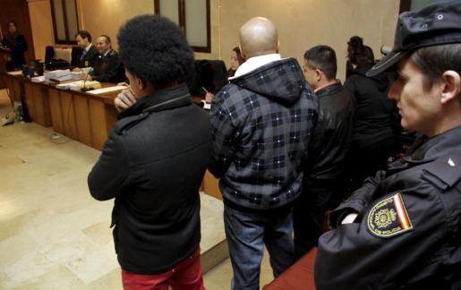 Algunos de los acusados en el banquillo.