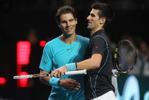 Nadal y Djokovic durante un partido de exhibición disputado en Chile.