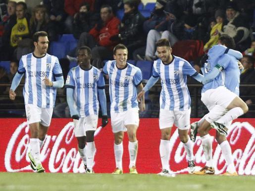 Los jugadores del Málaga celebran el gol del empate ante el Villarreal.